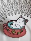 Katt i kopp, pin