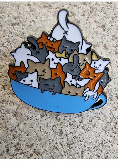 Katter i kopp, pin